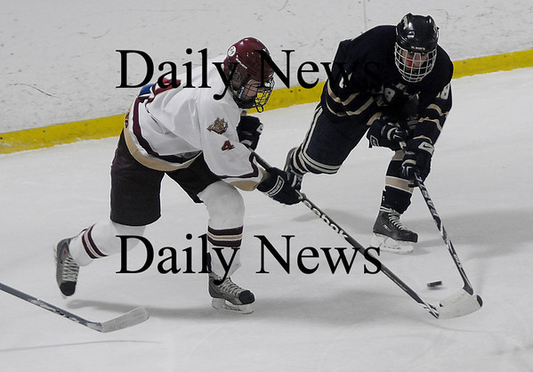 Newburyport: Newburyport's Cameron Roy fights for the puck with St Mary's Bryan Wilkins in the Bresnahan Division Final of Newburyport Bank Hockey Classic at the Graf Rink in Newburyport Friday night. Jim Vaiknoras/Staff photo