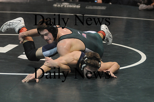 West Newbury: Pentucket's Austin Perrault  wrestles Triton's Cody Miller at the Division 3 North Sectional Individual Wrestling Tournament at Pentucket high in West Newbury Saturday night. Jim Vaiknoras/Staff photo