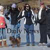 West Newbury: Lisa Cloutier, Andrea D'Ziadosz, Cindy Drislane, Tammy Messina and Libby Dore enjoy the bright sunshine and cold weather at the Annual Mill Pond Winter Carnival Sunday in West Newbury. JimVaiknoras/Staff photo