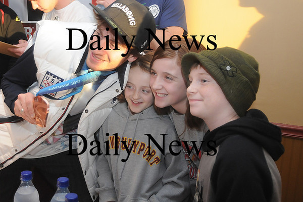 Amesbury: Olympian Scotty Lago poses for a photo with fans Emily Dobson, 11, her sister Lizzie, 9 and their friend Ashton Clarke, 10, all from Newburyport, Sunday during an autograph signing at Amesbury Sports Park. About 200 people showed up for the event. Jim Vaiknoras/Staff photo