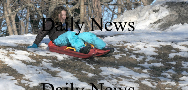 Newburyport:Hannah Burque, 9, of Newbury,sleds on the snowy grass at March's Hill in Newburyport. Hannah was at the hill with her brother Ryan, 7.