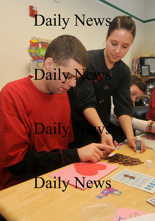 Newburyport: Dayhab director Melissa Bedell of the Opportunity Works helps Bob Pearson with a craft on  Opportunity  Way in Newburyport. Jim Vaiknoras/Staff photo