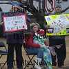 Seabrook:Inga Chase, Genessa Carrillo, her daughter, Julesiya, and husband Julio all of Seabrook hold signs and cheer for  Olympian Scotty Lago at a parade in his honor Sunday. Jim Vaiknoras/Staff photo