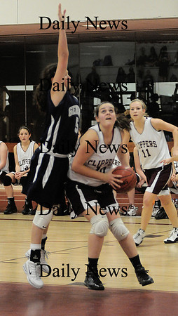 Newbuyport: Newburyport's Beth Castantini scores under the basket against a Hamilton player Friday night at Newburyport. Jim Vaiknoras/Staff photo
