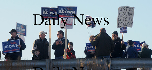 Newburyport: Supporters of senatorial candidate Scott Brown hold signs on the Gillis Bridge during teh Martha Coakley rally at Michael's Harborside in Newburyport. Jim Vaiknoras/Staff photo