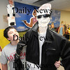 Byfield: Nick Farago , 12, stands with a cut out of Arnold Schwarzenegger he  made in Melenie Babenrider 7th grade class at Triton Middle School.The kids paired up to make the cutouts as part of a biography lesson. Jim Vaiknoras/Staff photo.