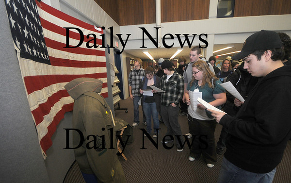 Byfield: Triton sudents look over items from World War 2 that were displayed at the Triton Library Thursday. Along with the items veteran spoke with student about their experiences. Jim Vaiknoras/Staff photo
