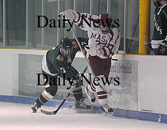 Haverhill: Pentucket's Max Mangano fights for the puck with Masco's Sean Haines at the Haverhill Valley Forum. The Sachem's game against Masco was their first since the death of team captain Matt McCarthy. Jim Vaiknoras/Staff photo