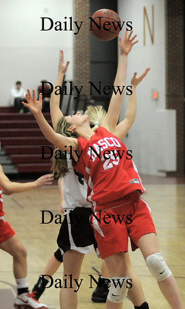 Newburyport: Masco player Julie Galvin grabs a rebound  Friday night at Newburyport high school. JIm Vaiknoras/Staff photo