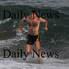 Salisbury: Nate Jenkins of North Andover enjoys a dip in the ocean after running in the Hangover Classic Road Race on Salisbury Beach. Traditionally runners in the race welcome the new year with a swim in the Atlantic. Jim Vaiknoras/Staff photo