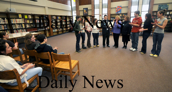 Byfield:Club officers on behalf of the Triton Community Service students recieve an award in the Triton library from Andre Gorgenyi of the Salvation Army after they raised $4,832 in the Army kettle drive over the Christmas holidays. Jim Vaiknoras/Staff photo