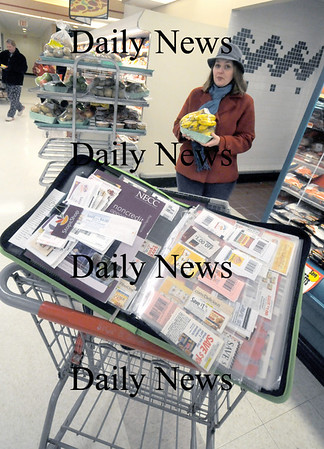 Amesbury: Jamie Chase <br /> with her coupon book at Stop and Shop in Amesbury. Jim Vaiknoras/Staff photo