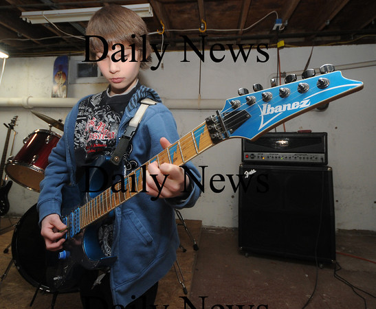 Amesbury: Middle School band Audio Rush Garrett Collins on guitar. Jim Vaiknoras/Staff photo
