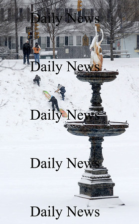 Newburyport: Sledders srcamble back up the hill at the Bartlet Mall in Newburyport Saturday. Jim Vaiknoras/Staff photo