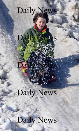 Newburyport: Drew Steinberg, 14, of Newburyport , kicks up some snow as he sleds down a big snow hill at the Winter Carnival on the Mall Sunday. The hill was made especially for the event and was a big hit. Jim Vaiknoras/Staff photo