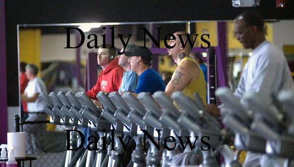 Newburyport; People workout on the ellipical machine at Planet Fitness in Newburyport. JIm Vaiknoras/Staff photo