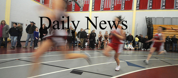 North Andover: Students from Amesbury, Masconomit, North Andover , and Newburyport sprint around the track at North Andover High as the compete in the 300during the meet  Saturday. Jim Vaiknoras/Staff photo