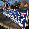 Newburyport: Supporters of senatorial candidate Martha  Coakley hold signs at thre roads in Newburyport Saturday morning. Jim Vaiknoras/Staff photo
