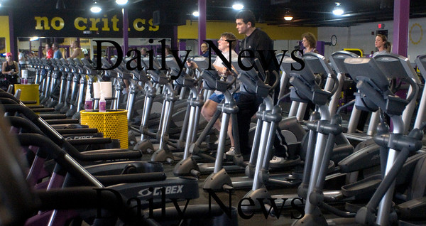 Newburyport; People workout at Planet Fitness in Newburyport. JIm Vaiknoras/Staff photo