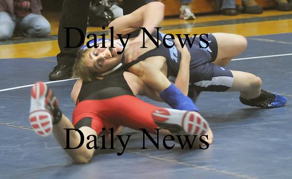 Byfield:Triton's Colton Blanchette wrestles North Andover's Jason Ricketts Wednesday at Triton. Jim vaiknoras/Staff photo