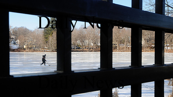 Amesbury: A hockey player glides along the ice on Patten's Pond in Amesbury Sunday afternoon. Jim Vaiknoras/STaff photo