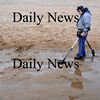 Newbury: Marc Cierri of Lawrence,uses a metal detector to search for valuables on Plum Island Sunday. The low tide drew about a dozen treasure  hunter to the beach.Jim Vaiknoras/Staff photo