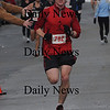 Salisbury: 10k winner Terrance Shea in the Hangover Classic Road Race on Salisbury Beach. . Jim Vaiknoras/Staff photo