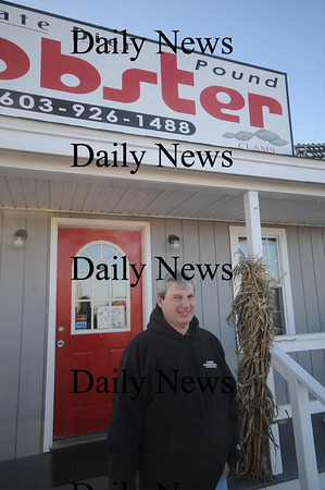 """Hampton: Richard Syphers of Amesbury poses infront of his Hampton buisiness State Line Pier Lobster Pound in Hampton. Syphers worked as an extra in teh Mel Gibson movie """" Edge of Darkness"""" parts of which were filmed in teh area. Jim Vaiknoras/Staff photo"""