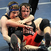 Byfield:Triton's Joe Chandler wrestles North Andover's Brody Kelley Wednesday at Triton. Jim vaiknoras/Staff photo