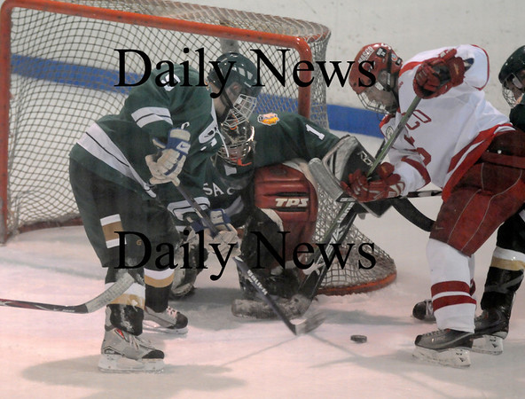 Haverhill: Pentucket's John Gavin fights for the puck with Masco's Chris Roach at the Haverhill Valley Forum Wednesday night. The Sachem's game  was their first since the death of team captain Matt McCarthy. Jim Vaiknoras/Staff photo