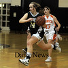 Ipswich: Pentucket's Ashley Viselli drives past Ipswich's Brigid O'Flynn during their game at Ipswich Friday night. Jim Vaiknoras/Staff photo
