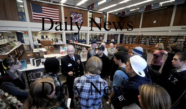 Byfield:Submariner  Senior Chief Engineman Doug Bryan talks with students at the Triton Library Thursday. . Jim Vaiknoras/Staff photo