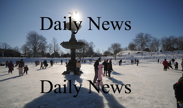 Newburyport:Skaters are warmed by the sun as the make their way around the frozen Frog Pond at the Winter Carnival on the Mall in Newburyport Saturday. Hundreds enjoyed a day of skating , sledding, hockey and fun. Jim  Vaiknoras/Staff photo