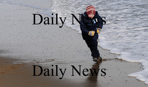 Salisbury: Connor Young, 5, plays chicken with the surf on Salisbury Beach Sunday afternoon. He would run up to the water as it was drawing out , then let it chase him as the waves came back in.Jim Vaiknoras/Staff photo