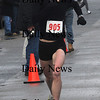 Salisbury: 10k female winner Mandy Ivey in the Hangover Classic Road Race on Salisbury Beach. . Jim Vaiknoras/Staff photo