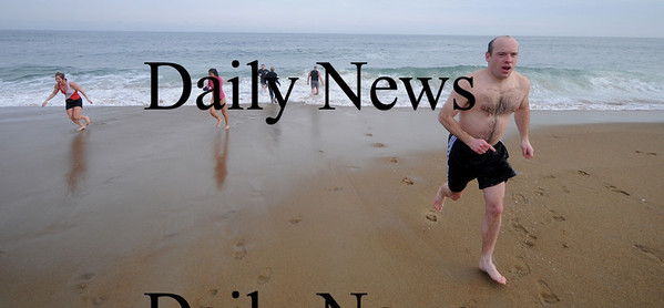 Salisbury: Runners enjoy a dip in the ocean after participating  in the Hangover Classic Road Race on Salisbury Beach. Traditionally runners in the race welcome the new year with a swim in the Atlantic. Jim Vaiknoras/Staff photo