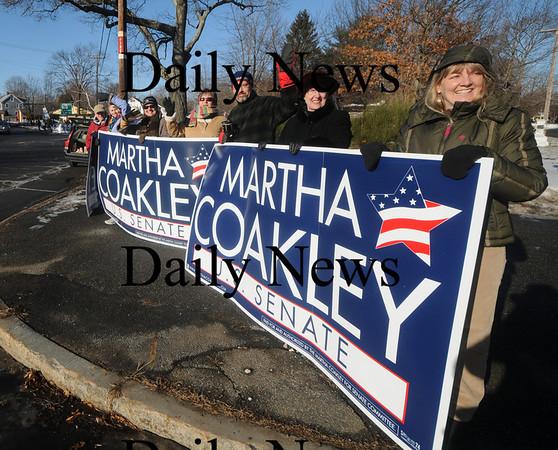 Newburyport: Supporters of senatorial candidate Martha  Coakley hold signs at thre roads in Newburyport Saturday morning. Jim Vaiknoras/Staff photo