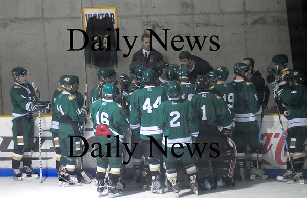 Haverhill: Pentucket coachs talk with their players before their game against Maco at the Haverhill Valley Forum. The game was the first for the Sachems since the death of team captain Matt McCarthy. His jersey was hung behing the bench. Jim Vaiknoras/Staff photo