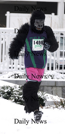 Salisbury: Brenden Guinee dressed as a gorilla  in the Hangover Classic Road Race on Salisbury Beach. Traditionally runners in the race welcome the new year with a swim in the Atlantic. Jim Vaiknoras/Staff photo