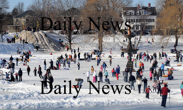 Newburyport: Skaters move about on the frozen Frog Pond at the Winter Carnival on the Mall in Newburyport Saturday. Hundreds enjoyed a day of skating , sledding, hockey and fun. Jim  Vaiknoras/Staff photo