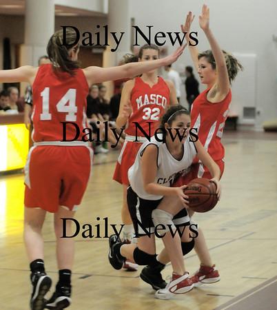 Newburyport: Newburyport's Molly Rowe is fouled as she drives to the hoops against Masco Friday night at Newburyport high school. JIm Vaiknoras/Staff photo