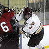 Newburyport: Newburyport's Kyle McElroy (3) lays a hit on Gloucester's Vincenzo Terranova (6) during Monday's game at the Graf Rink. Photo by Ben Laing/Staff Photo