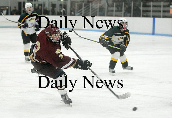 Reading: Newburyport's Kyle McElroy (3) scores on a short-handed breakaway in the second period of Saturday night's 8-3 win over North Reading. Photo by Ben Laing/Staff Photo