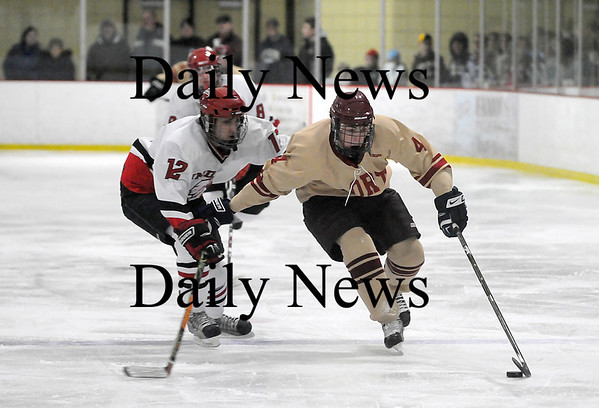 Newburyport: Cameron Roy (4) of Newburyport skates around Amesbury's Justin Issac (12) during Wednesday night's 3-1 victory over the Indians. Photo by Ben Laing/Staff Photo