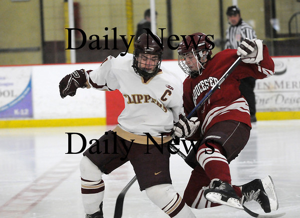 Newburyport: Newburyport's Ryan Cutter (11) lays a big hit on a Gloucester Fisherman during Monday's game at the Graf Rink. Photo by Ben Laing/Staff Photo