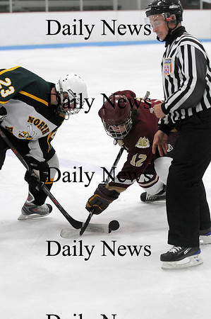 Reading: David Cusack (12) fights for a face off during Saturday night's 8-3 win over North Reading. Photo by Ben Laing/Staff Photo