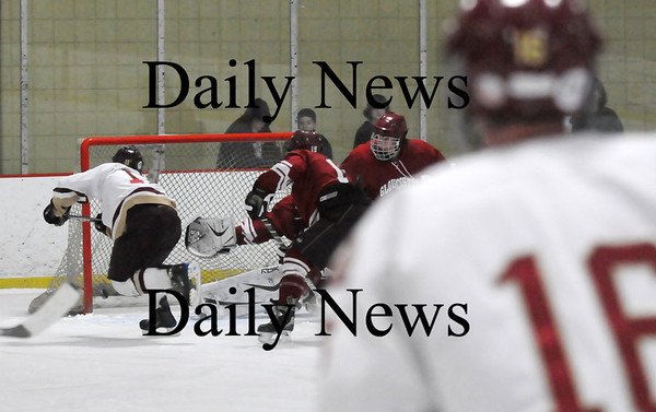 Newburyport: Newburyport's Ryan Cutter (11) slips the puck past the Gloucester goalie during Monday's game at the Graf Rink. Photo by Ben Laing/Staff Photo
