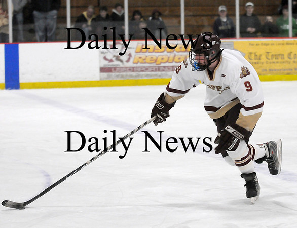 Newburyport: Newburyport's Kris Holmes (9) skates the puck up the ice during Monday's game against Gloucester at the Graf Rink. Photo by Ben Laing/Staff Photo