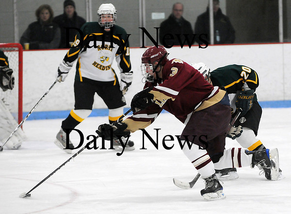 Reading: Newburyport's Kyle McElroy (3) skates past a North Reading defender during Saturday night's 8-3 win. Photo by Ben Laing/Staff Photo