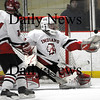 Newburyport: Amesbury goalie Matt Irwin (30) makes a glove save early in Wednesday night's game against Newburyport. Photo by Ben Laing/Staff Photo